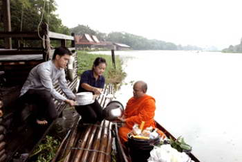 Alms to monk, Rose Garden Riverside, Thailand