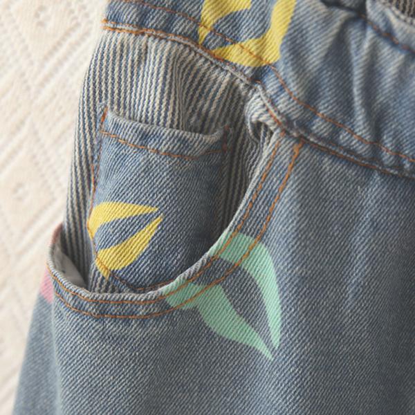 กางเกงยีนส์ขาพิมพ์ลายปาก แต่งพับปลายขา แฟชั่นวินเทจ