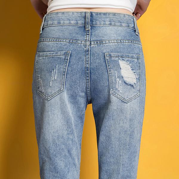 กางเกงยีนส์ขายาวแปดส่วน แต่งปะขาดแนวเซอร์